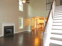 Two story living room with marble fireplace LaGrange GA new homes for sale